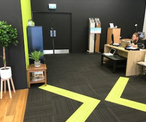 Browns Plains Flooring Xtra Queensland Store internal logo on the carpet