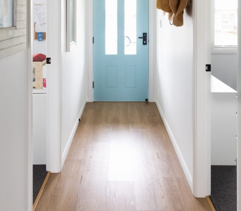 costal cottage project hallway showing blue door