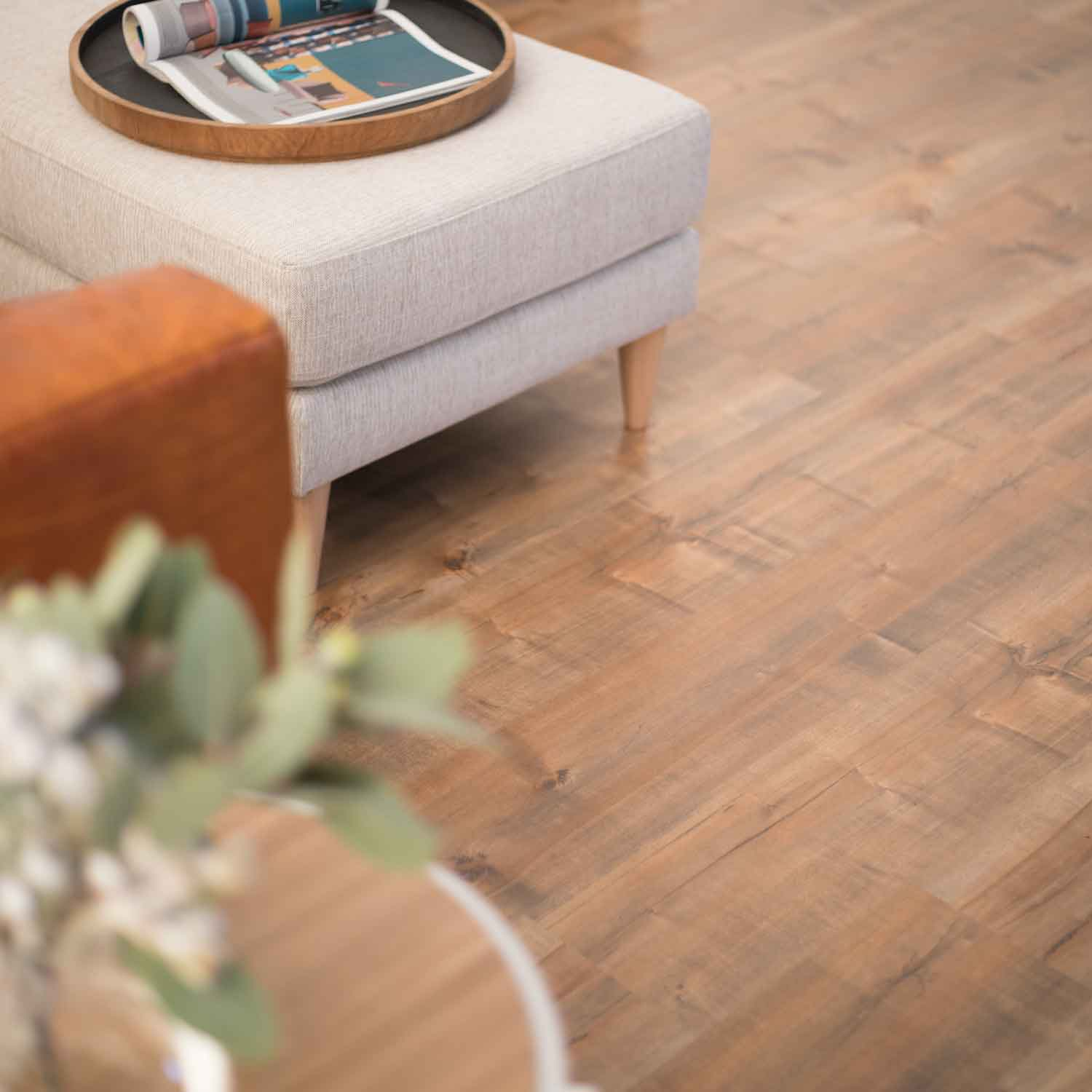 Bushland Mountain Gum Laminate Flooring Living Room with ottoman